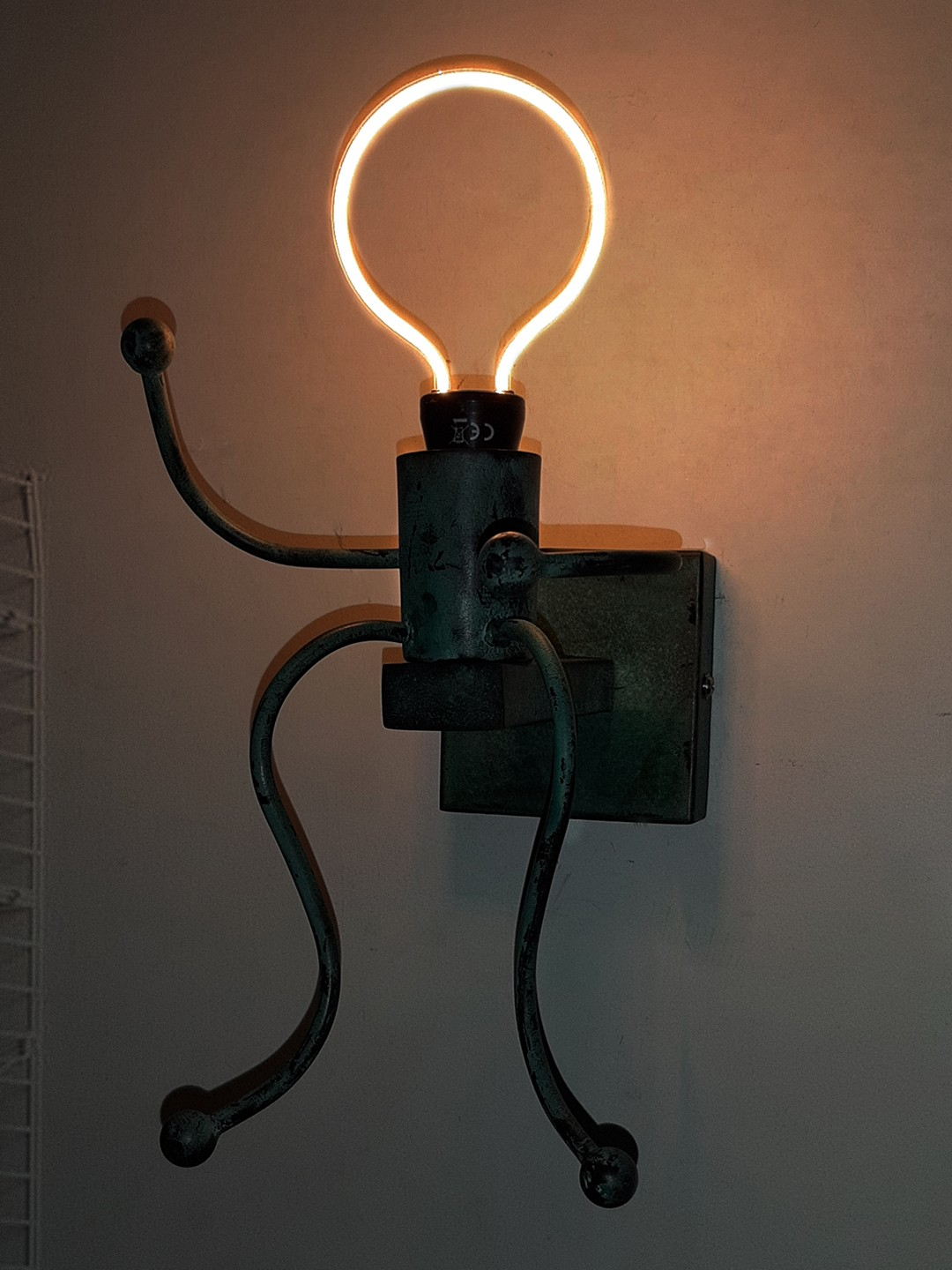 Stick Figure Patina Finished Small Wall Sconce