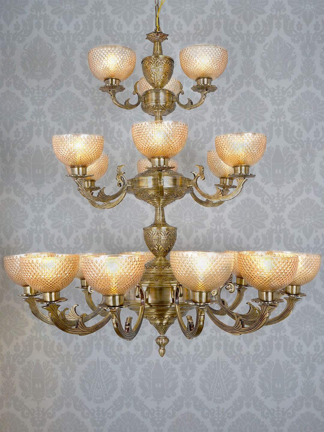 Traditional Meena Aluminium 21 Lights 3 Step Chandelier in Antique Brass Finish and Golden Cut Glass Textured Glass Shade for Foyer, Entrance, Hotels