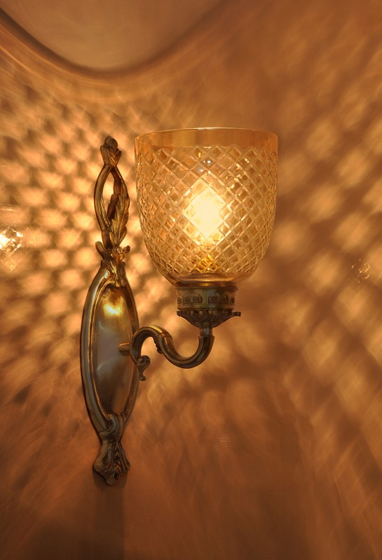 Brass vine single wall light in diamond cut lustrous glass